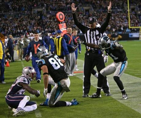 Olsen scored a touchdown in the third quarter with Patriots free safety Devin McCourty watching.
