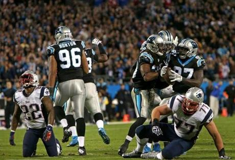 The Panthers were pumped after a fumble recovery. Patriots running back Stevan Ridley lost the ball.