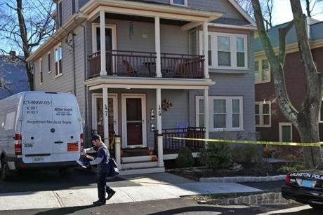 A mailman finished a delivery Tuesday near the scene where the bodies of family in Arlington were discovered.