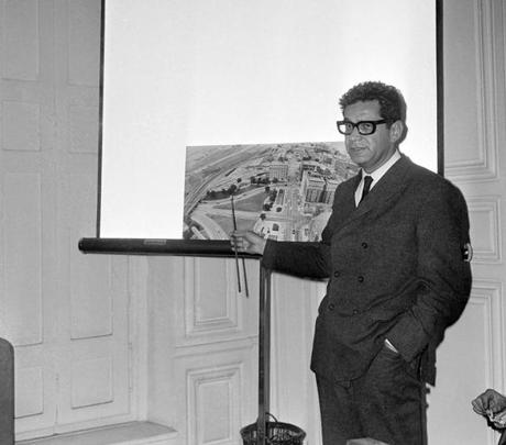 In this Oct. 4, 1966, photo, American lawyer Mark Lane pointed to a photo showing the route followed by President John F. Kennedy on Nov. 22, 1963 in Dallas, during a news conference in Paris criticizing the report of the Warren Commission.