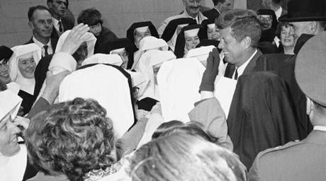 Smiling President John Kennedy made his way through a group of Catholic nuns after addressing the crowd at Redmon Place; Wexford, Ireland, June 27, 1963. The president was given the Freedom of the City.