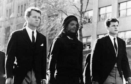 Robert Kennedy (left) and Edward Kennedy with their sister-in-law Jacqueline Kennedy during the funeral of President John F Kennedy.
