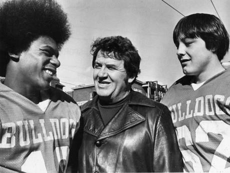 11/19/1976: Thanksgiving Day game between Lynn English and Lynn Classical at the Manning Bowl. Lynn English team members John Saunders, coach Bill Hall, and Bill Mason.