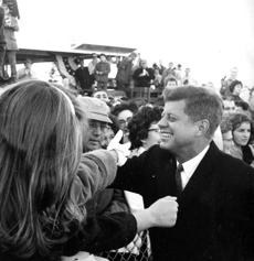 Nov., 11 1960: Cape Cod hands were extended for a farewell grasp by President-elect Kennedy at Barnstable Aiport as he left his Cape Cod home for a working vacation at Palm Beach, Fla. Two days before at his acceptance speech, President Kennedy told his Hyannis Port neighbors,