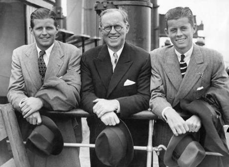 July 05 1938: John F. Kennedy (right) and his brother Robert (left) surrounded their father Joseph in Southampton, United Kingdom, on the deck of French