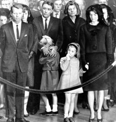 November 25 1963: Peter Lawford comforted his daughter, Sydney. From left are Robert Kennedy, Mrs. Patricia Lawford, Caroline Kennedy and Mrs. Jacqueline Kennedy.
