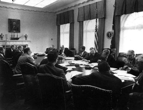 The scene at the White House when President John F. Kennedy met with his cabinet and advisers during the Cuban missile crisis in October 1962.  Attorney General Robert Kennedy could be seen at far left.