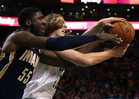Olynyk battled Roy Hibbert for a rebound.