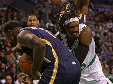 A jump ball was called as the Celtics' Gerald Wallace battled the Pacers' Lance Stephenson for the ball in the fourth quarter.