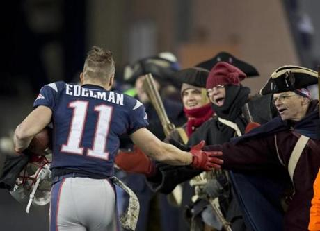 Edelman high-fived the End Zone Militia. The Patriots took a 34-31 win at Gillette Stadium in overtime.