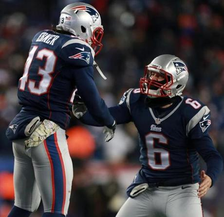 Nate Ebner (left) leaped in celebration after he recovered the punt that went off of the Broncos' Tony Carter (not pictured).
