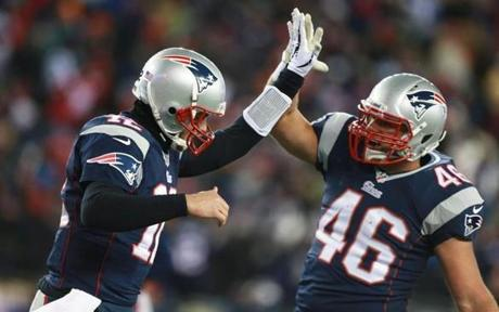Brady (left) and James Develin celebrated a fourth-quarter touchdown pass to Edelman.