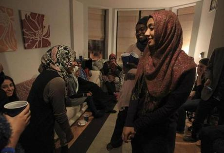 BU grad students Thanna Rajapakse (left) and Lameya Ahmed opened up their home on Thanksgiving for a potluck dinner.