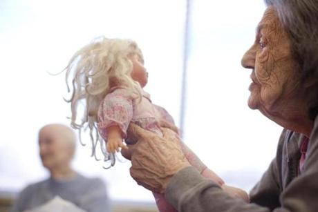 Betty Lee, a resident at Life Care Center of Nashoba Valley nursing home in Littleton, talked to her baby doll during activity time.