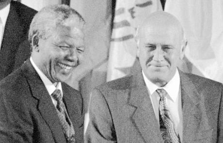 His predecessor and fellow Nobel recipient, F. W. de Klerk (right), served as Mandela's deputy president.