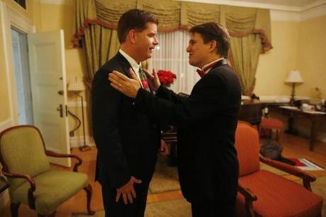 Marty Walsh went over last-minute instructions with Boston Pops conductor Keith Lockhart on Wednesday.