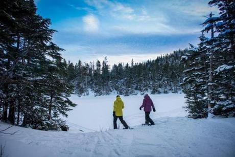 In Vermont, snowshoers explore Sterling Pond in Smugglers Notch.