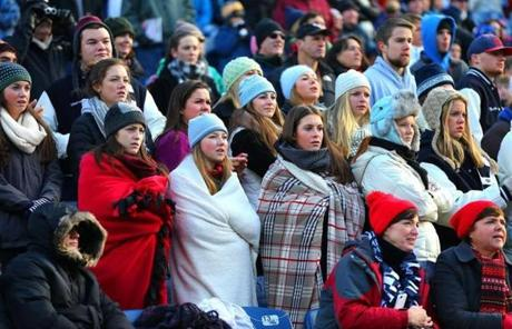 Cohasset fans bundled up to watch the game early Saturday.