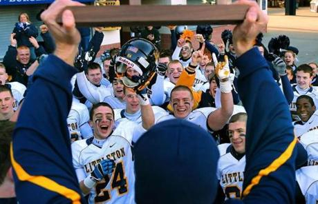 Littleton players celebrated the 52-35 win over Cohasset.
