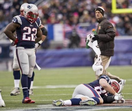Stevan Ridley stood over Gronkowski after the tight end suffered an apparent knee injury.