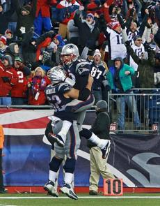 Brady howled and leaped into the arms of offensive lineman Ryan Wendell.