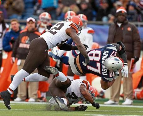 T.J. Ward (bottom) hit Rob Gronkowski in the third quarter.