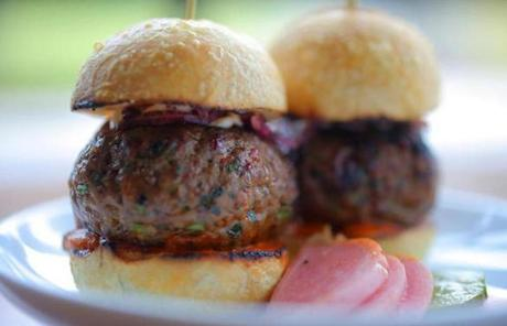 Lamb kofte sliders are served with tomato brown butter and pickles.