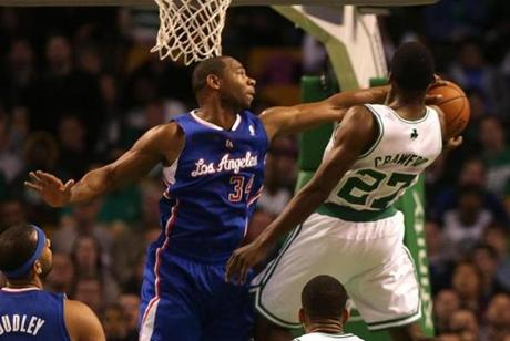 Jordan Crawford was fouled as he went up for a layup by Clippers shooting guard Willie Green.