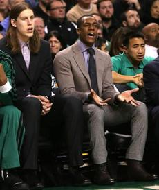 Rajon Rondo disagreed with a call while watching from the Celtics bench.