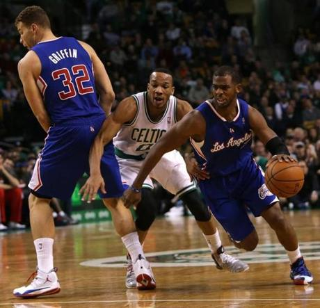 Avery Bradley tried to fight through a pick set by Blake Griffin asChris Paul headed for the basket.