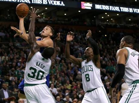Blake Griffin threaded the Celtics' defense en route to a layup in the second half.