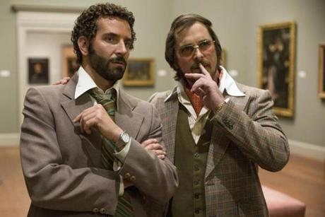 "Cooper (left) and Christian Bale in ""American Hustle."""
