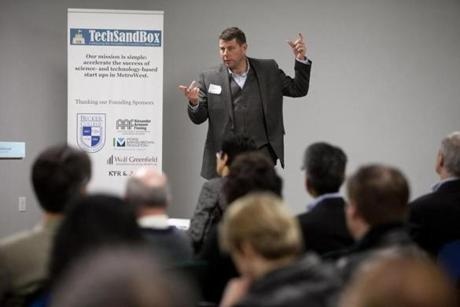 Gareth Charter of VidiLocal presents a business pitch during a TechSandBox forum.