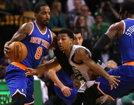 Pressey fought through a pick set as he played defense against J.R. Smith.