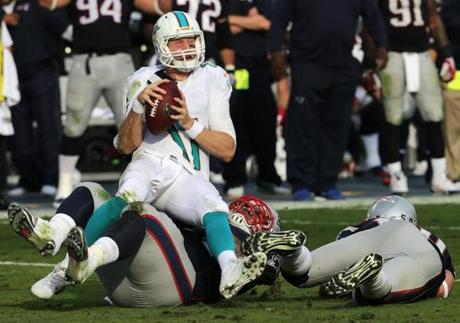 The Patriots' Jamie Collins and Ninkovich sacked Ryan Tannehill.