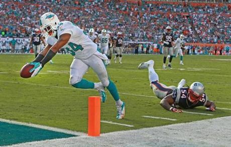 Marcus Thigpen left Dont'a Hightower behind as he scored in the Dolphins' game-winning touchdown.