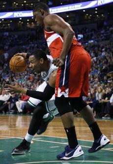 Jared Sullinger drove to the basket while Kevin Seraphin guarded.
