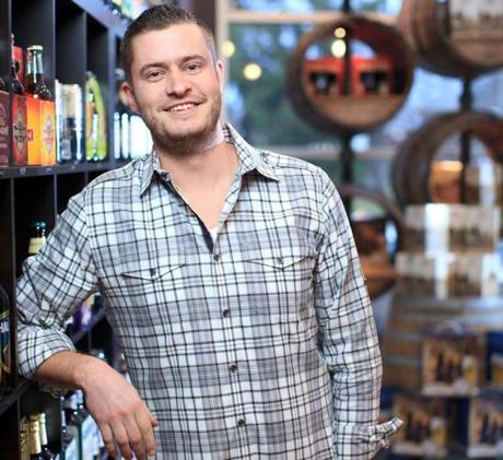 Brian Shaw, who opened a Craft Beer Cellar in Newton Centre recently, says business has been brisk.