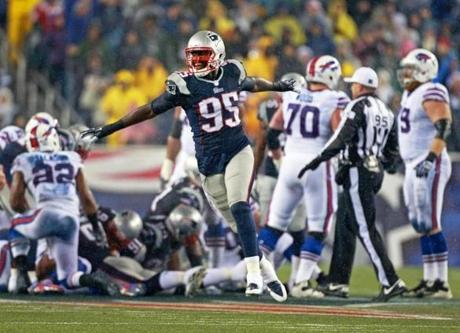 Chandler Jones celebrated after the Patriots' defense stopped the Bills on a fourth-and-one in the second quarter.