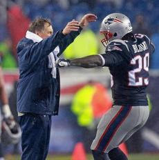 Coach Bill Belichick had a smile and a hug for Blount after the running back was removed from the game late in the fourth quarter.