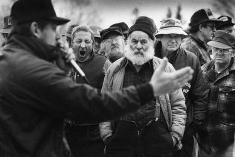 May 6, 1991: Local farmers looked on during the auction of machinery at Alan Young's farm in Craftsbury, Vermont. The Youngs auctioned 111 cows, 2,000 bales of hay, corn planters, and fertilizer spreaders after plunging milk prices put them into debt.