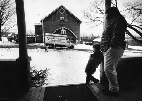 May 6, 1991: Anita Young and her son Richard watched from the front porch as auctioneers arrived at Seaver Brook Farm to organize the auction of the farm animals and equipment in Craftsbury, Vt.