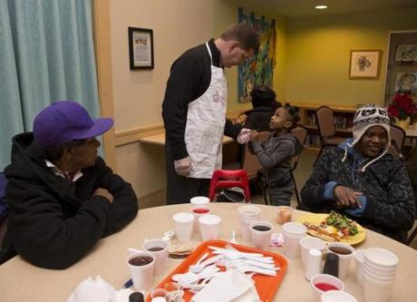 Mayor-elect Martin J. Walsh greeted Shaveya Talbert, 6, her mother, Yolanda (left), and Teresa Hudson during dinner served at Rosie's Place in Boston Friday.