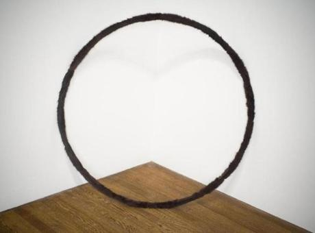 """Hoop,"" a piece covered in fur by Claire Barclay."