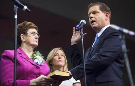 Martin Walsh was sworn in as mayor of Boston as his mother, Mary Walsh, and partner, Lorrie Higgins, looked on.
