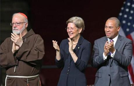 Cardinal Sean P. O'Malley, Senator Elizabeth Warren, and Governor Deval Patrick applauded.