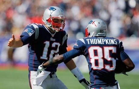 Tom Brady and Kenbrell Thompkins celebrated after Tompkins's first touchdown.