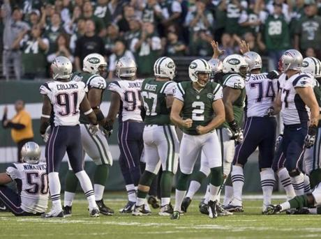 The Jets celebrated after beating the Patriots in overtime.