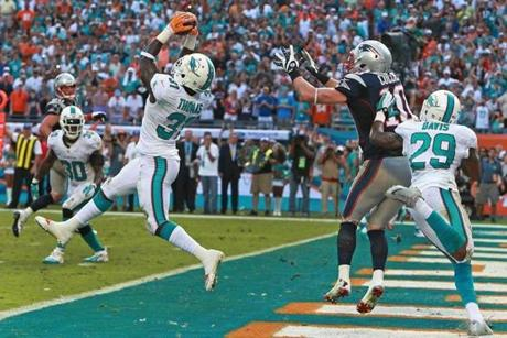 Michael Thomas intercepted Tom Brady to seal the win for Miami.