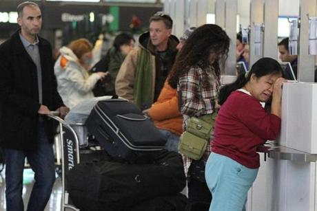 The frustration was evident as passengers waited at Logan Airport on Tuesday to rebook flights. More than 1,300 arrivals and departures have been canceled since Jan. 2.